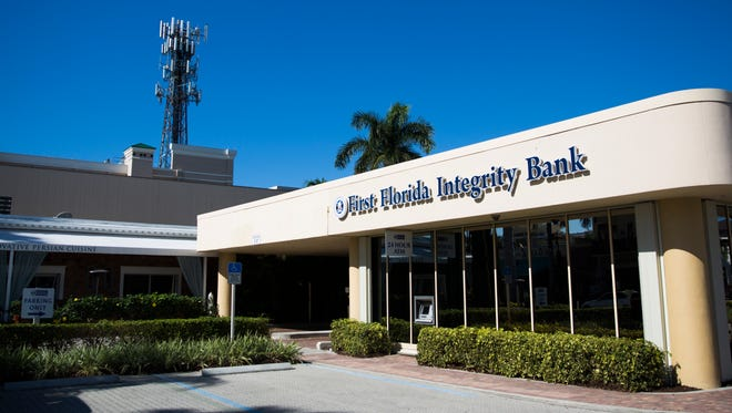 895 Fifth Ave. S. houses First Florida Integrity Bank on Thursday, Dec. 29, 2016, in downtown Naples. Two buildings on the street were recently sold.