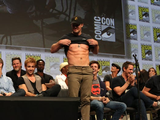 """Stephen Amell stands with stars and executive producers from Gotham, Constantine, The Flash and Arrow as they attend attend the """"Warner Bros. Television Presents A Night of DC Entertainment"""" at Comic-Con International 2014 on July 27, 2014  in San Diego, California."""