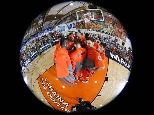 Syracuse Orangemen  huddle prior to their game against the Baylor Bears during the championship game of the EA Sports Maui Invitational at  the Lahaina Civic Center.