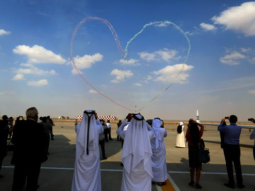 The United Arab Emirates Air Force Aerobatic Team, Al-Fursan, performs during the Dubai Airshow on Nov. 19, 2013.