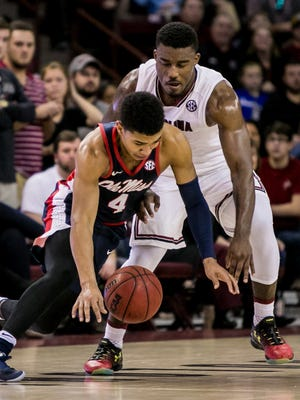 Ole Miss' Breein Tyree loses the ball to South Carolina's Duane Notice in Saturday's loss.
