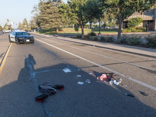Visalia police investigate a stabbing that occurred in Crestwood Park on Thursday, August 30, 2018. A male was taken to KDMC with life-threatening wounds after he staggered from the park through a nearby parking lot and collapsed in the eastbound lane of Whitendale.