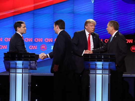 The Republican candidates shake hands at the end of