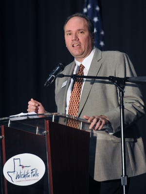 Dwayne Bivona, president of the Wichita Falls Times Record News and immediate past chairman of the Wichita Falls Chamber of Commerce, addresses the audience Wednesday during the chamber's annual meeting.