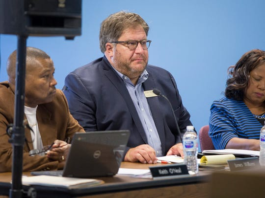 James William listens to his fellow board members during