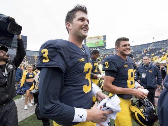 Quarterback Wilton Speight, left, is battling to maintain