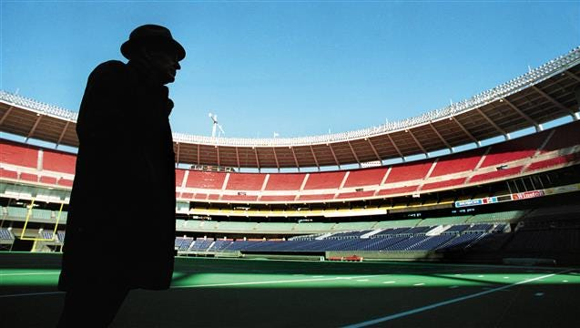 NOVEMBER 30, 1989: Cincinnati Bengals owner Paul Brown, in his ever-present trademark fedora and trenchcoat stand on the AstroTurf at Riverfront Stadium.