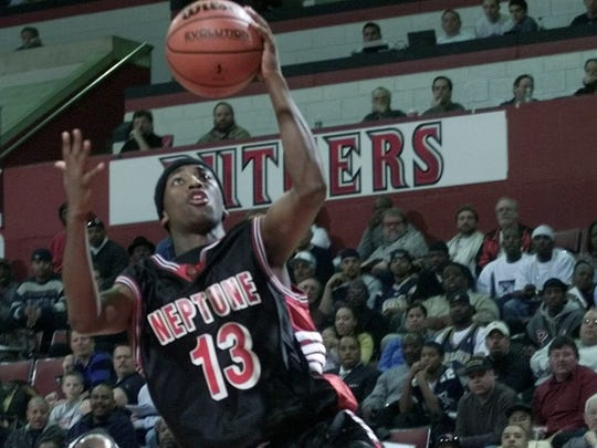 Neptune's Terrance Todd scores in the first half against Weequahic in NJSIAA game in 2002.