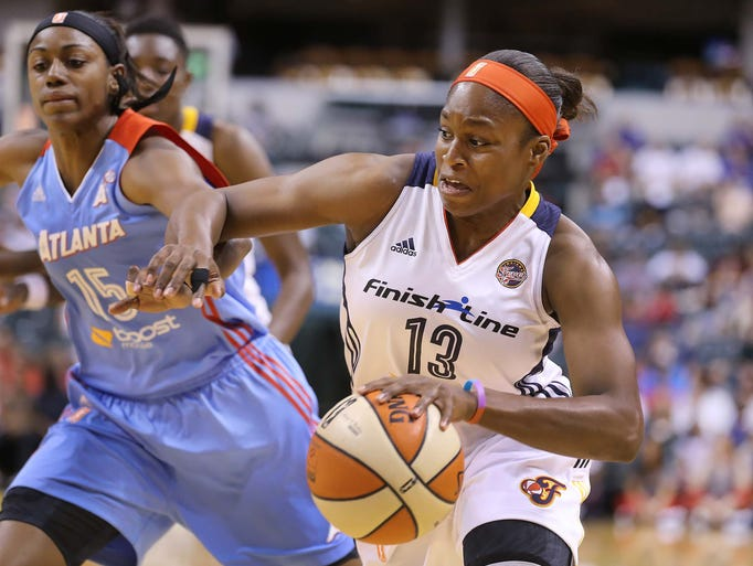 Karima Christmas of the Fever drives against defender Tiffany Hayes. The Indiana Fever lost to the Atlanta  Dream 76-68 in WNBA action at Bankers Life Fieldhouse Sunday June 29, 2014.