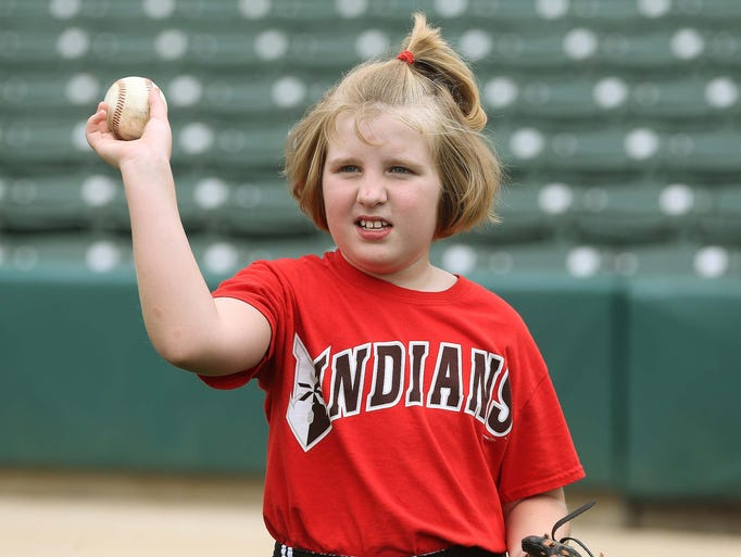 Lexi Dabney, 10, Indianapolis tosses the ball during the clinic. Children and adults with special needs learned about baseball from the pros when the Indianapolis Indians spent time with clients from DAMAR Services at Victory Field Saturday August 9, 2014.