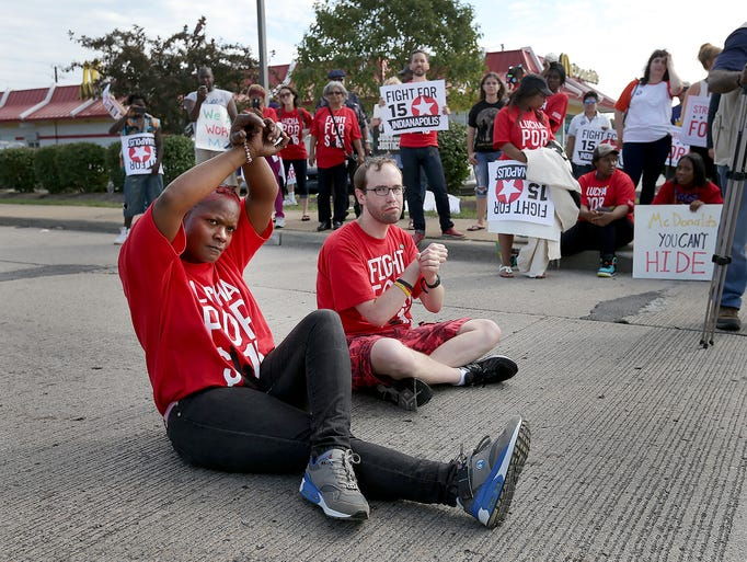 A group of fast-food workers outside the McDonald's at 38th and Post Road held a protest Thursday morning for higher wages. IMPD escorted numerous protesters away and issued them citations for blocking traffic on Post Road.