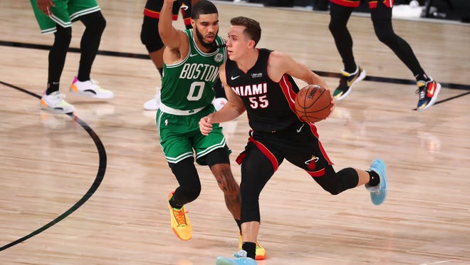 Sep 19, 2020; Lake Buena Vista, Florida, USA; Miami Heat guard Duncan Robinson (55) dribbles the ball against Boston Celtics forward Jayson Tatum (0) during the second half of game three of the Eastern Conference Finals of the 2020 NBA Playoffs at ESPN Wide World of Sports Complex. Mandatory Credit: Kim Klement-USA TODAY Sports