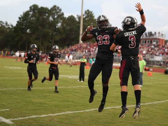 Chiles' Amari Gainer, left, and Garrett Greene celebrate