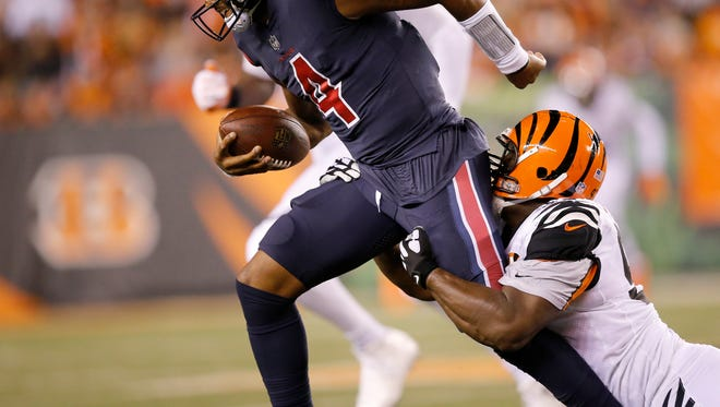 Houston Texans quarterback Deshaun Watson (4) is sacked by Cincinnati Bengals defensive tackle Geno Atkins (97) in the second quarter of the NFL Week 2 game between the Cincinnati Bengals and the Houston Texans at Paul Brown Stadium in downtown Cincinnati on Thursday, Sept. 14, 2017. The Texans led 10-6 at halftime.