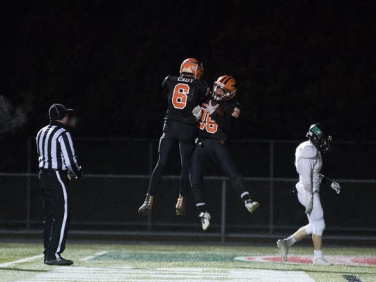 Iola-Scandinavia celebrates a touchdown during the playoff matchup with Regis.