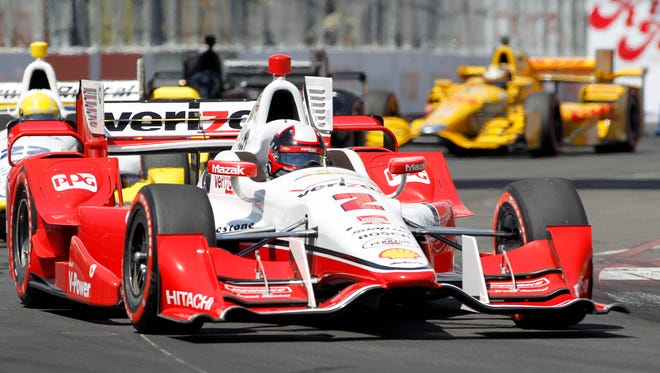 Juan Pablo Montoya (2), of Colombia, drives in the IndyCar Toyota Grand Prix of Long Beach auto race in 2015.