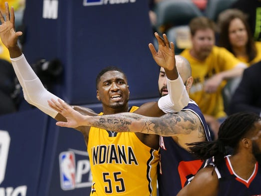 Pacers center Roy Hibbert is pressured by Atlanta Hawks center Pero Antic towards the end of the second half of Saturday's Eastern Conference playoff game against the Atlanta Hawks at Bankers Life Fieldhouse on April 19, 2014. The Pacers lost 93-108.