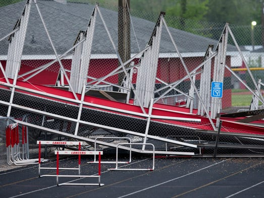 Damage to bleachers at Edinburgh High School, caused by wind the evening before, Edinburgh, Wednesday, May 14, 2014. Nobody was injured in the collapse on the athletic field.