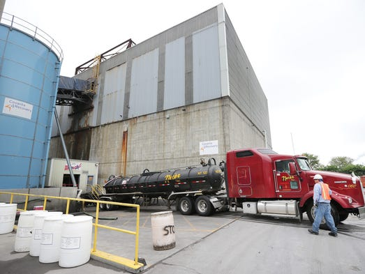 A truck carrying liquids backs into Covanta, an energy