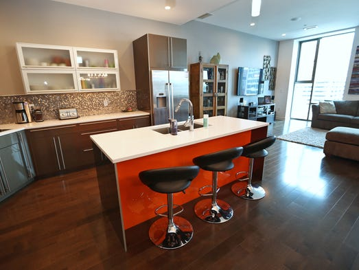 An open layout is in the main living area in this sixth-floor luxury condo at Allen Plaza located at 1 Virginia Ave.  This is the kitchen off the living room.