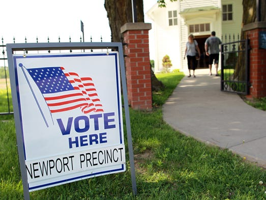 A voting sign marks St. Mary's Newport Church on Tuesday, June 3, 2014.  David Scrivner / Iowa City Press-Citizen