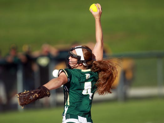 West High's Jessie Harder delivers a pitch during the Women of Troy's game against Davenport West on Monday, July 14, 2014. David Scrivner / Iowa City Press-Citizen
