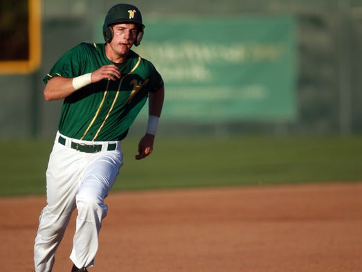 West High's Nate Boland makes his way to third base during the Trojans' game against Burlington on Wednesday, July 23, 2014. David Scrivner / Iowa City Press-Citizen