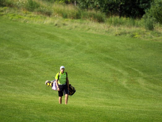 West High's Noah Federici makes his way down the 4th hole fairway of Blue Top Ridge during the West High Invitational in Riverside on Tuesday, Aug. 19, 2014. David Scrivner / Iowa City-Press Citizen