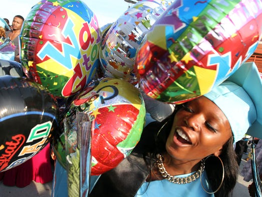 Asbury Park High School graduate Ikeyia Richardson is surrounded by a sea of balloons after ceremonies held at the Paramount Theater in Asbury Park, NJ, Monday, June 23, 2014.