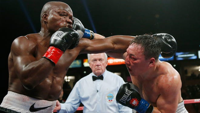 Timothy Bradley, left, takes a punch from Ruslan Provodnikov, of Russia, in the 10th round of their WBO welterweight title boxing match in March 2013. The fight was named Fight of the Year.