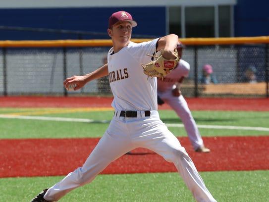 Arlington High School pitcher Matt McGowan delivers