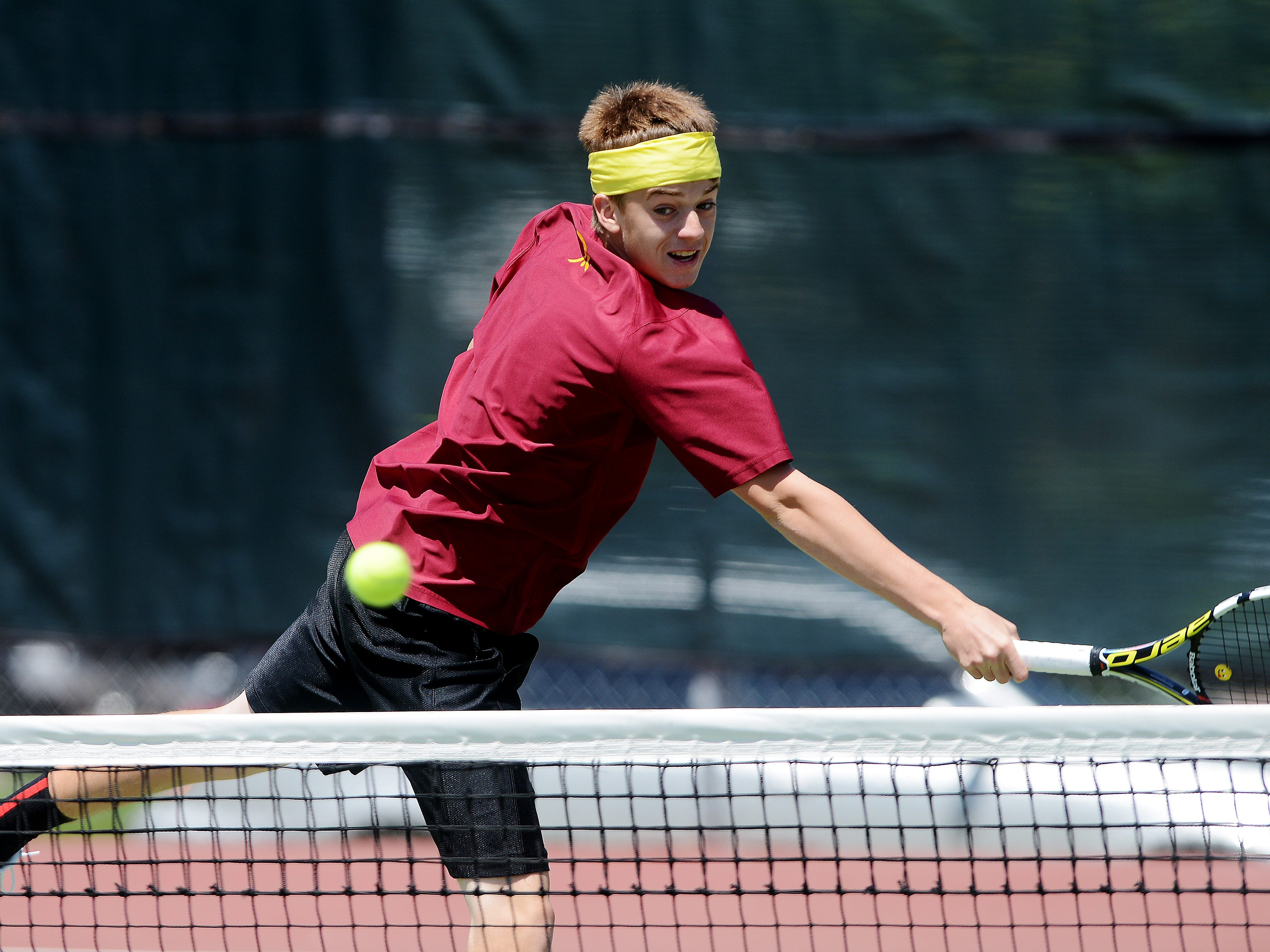 Logan Barr of Roosevelt returns a shot as he and Spenser Smith play Hunter Rockne and Luke Rockne of Yankton in a first-flight doubles match Thursday at the state tennis tourney.