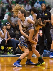 Mardela's Taylor Ross fights Walkersville's MacKenzie White for the ball during the Governor's Challenge at the Wicomico Youth & Civic Center.