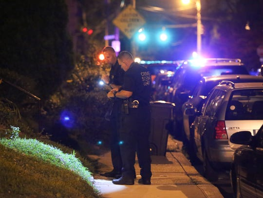 Wilmington police investigate at the scene of a shooting