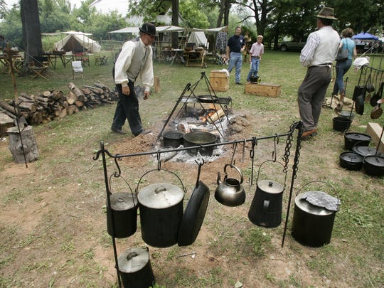 Campers learn about life as a Civil War soldier at Smyrna's Sam Davis Home.