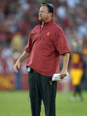 Southern California offensive line coach Tim Drevno works against the Fresno State Bulldogs.
