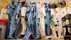 Biohazard suits hang inside a biosafety level 4 laboratory