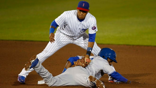 Iowa Cubs second baseman Addison Russell applies the late tag to Oklahoma City Dodgers' Darnell Sweeney Friday, April 17, 2015 as Sweeney steals second during the Iowa Cubs home opener at Principal Park in Des Moines.