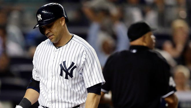 The Yankees' Carlos Beltran walks to the dugout after striking out looking to end Friday night's 1-0 loss to the Kansas City Royals at Yankee Stadium.