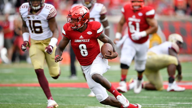 Sep 17, 2016; Louisville, KY, USA;  Louisville Cardinals quarterback Lamar Jackson (8) runs the ball against the Florida State Seminoles during the second half at Papa John's Cardinal Stadium. Jackson accounted for five touchdowns as Louisville defeated Florida State 63-20.