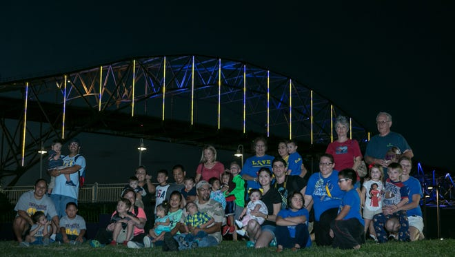 Families gathered at the Corpus Christi Water Gardens Oct. 24 to see the Harbor Bridge light up blue and yellow for Down Syndrome Awareness Month.