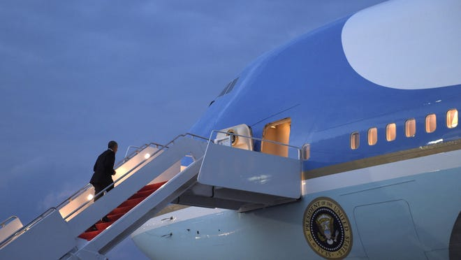 President Barack Obama walks up the steps of Air Force One at Andrews Air Force Base in Md., Wednesday, July 27, 2016. Obama is traveling to Philadelphia to speak at the Democratic National Convention. (AP Photo/Susan Walsh)