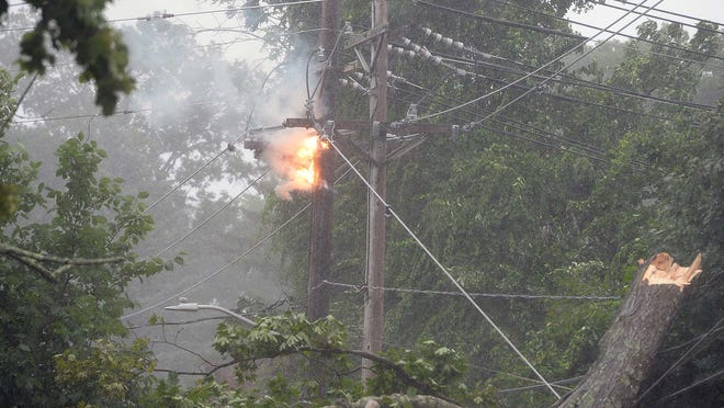 Tropical Storm Isaias causes a high-voltage transformer fire and knocks down a tree on Torrey Street in Brockton,  on Tuesday,  August 4, 2020