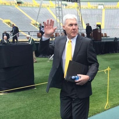 Green Bay Packers general manager Ted Thompson waves