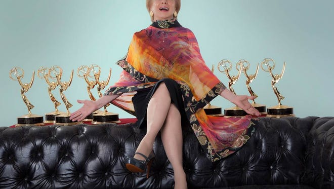 Cloris Leachman poses with her Emmys. She's won eight Primetime Emmy Awards, more than any other actor.