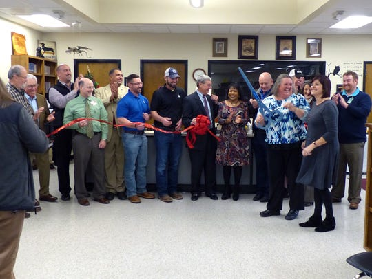 Officials cut the ribbon of a new library at L. Leo