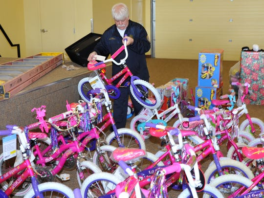 Wichita Falls Fire Department Operation Santa Claus president Randall Reel sorts through donated bicycles Friday morning. WFFD suffered a major setback after the storage container used to keep gifts and bicycles was burglarized earlier this year.