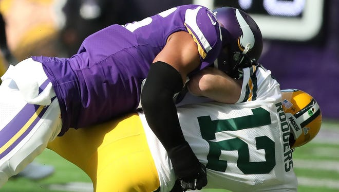 Green Bay Packers quarterback Aaron Rodgers gets flattened by Minnesota outside linebacker Anthony Barr during their Oct. 15, 2017, game in Minneapolis, injuring Rodgers' shoulder. Jim Matthews/USA TODAY NETWORK-Wisconsin