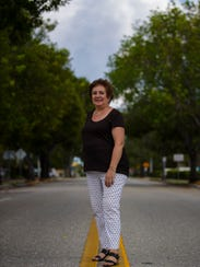 Longtime Cape Coral resident Linda Biondi  stands along