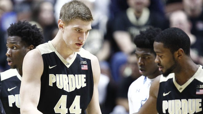 Purdue center Isaac Haas (44) and guard Rapheal Davis (35) have helped the Boilers to an 11-0 record.
